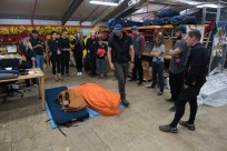Field-trainer Cole showing us how to pack our sleeping bags