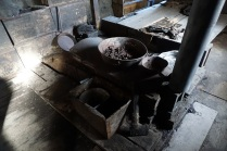 "The stove and ""bed"" in the background - looks pretty cold"